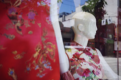 Reflecting Chinatown (Eric Flexyourhead) Tags: vancouver canada britishcolumbia bc chinatown eastpender penderstreet city urban detail fragment shop store window reflection chinese dress mannequin sonyalphaa7 zeisssonnartfe35mmf28za zeiss 35mmf28