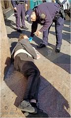 Wake up Sir. (TheeErin) Tags: people nyc streetculture everydaypeople cops gesture homeless
