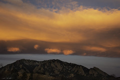 Slipstream (courtney_meier) Tags: boulder bouldercounty colorado coloradorockies flatironformation flatirons fountainformation landscape rockymountains southernrockies winter cloud clouds dawn morning morninglight mountains pinkclouds sunrise wavecloud