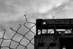 (jimiliop) Tags: abandoned industrial building fence broken sky blackandwhite decay