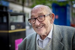Stranger 74/100 'Eddie' (Leanne Boulton) Tags: 100strangers portrait urban street portraiture streetphotography streetportrait eyecontact streetlife sociallandscape old elderly aged man male face eyes smile smiling expression mood emotion feeling story energy cheeky character personality tone texture detail depthoffield bokeh naturallight outdoor light shade city scene human life living humanity society culture lifestyle people canon canon5dmkiii 70mm ef2470mmf28liiusm color colour glasgow scotland uk