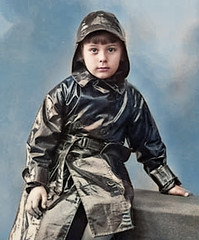 Black raincoat (theirhistory) Tags: boy child kid coat hat souwester raincoat mackintosh