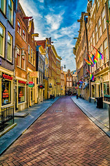 Rainbow Street Scene (Charles Patrick Ewing) Tags: landscape cityscape street city clouds sky outdoor colorful beautiful fave faves new all everything landscapes architecture urban holland netherlands art artistic perspective buildings rainbow rainbows flag flags gay great refelctions
