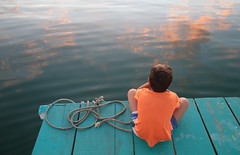 Reflections At Dusk (peterkelly) Tags: digital canon 6d northamerica gadventures mayandiscovery centralamerica guatemala flores lakepeténitzá water lake blue boat rope pontoon clouds reflection boy orange sitting sunset evening dusk