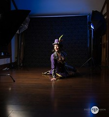 Behind the scenes shot from a fun Max Moxxi shoot with KissyCosplay. One gelled back light with a silver umbrella. Key light is a medium soft box. I try to be careful when using colored gels so that it doesn't distract if it shows up on the skin. There ar (PhotoPersuasion) Tags: photopersuasion dallas photography cosplay