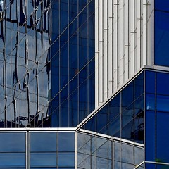 Glass Geometry (2n2907) Tags: abstract architecture reflection windows glass building skyscraper graphic geometric geometry modern shapes olympus omd digital mirrorless patterns