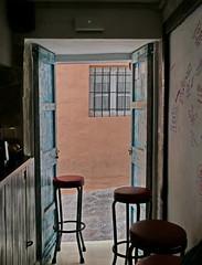 Coffee Break (louise peters) Tags: cafe bar coffee coffeebreak daltvila ibiza straatje steegje koffiepauze barkruk alley barstool insideout muur window raam deur door schilderachtig piittoresk picturesque