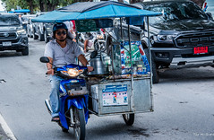 2019 - Koh Samui - Nathon Town Chonwithi Rd (Ted's photos - For Me & You) Tags: 2019 cropped kohsamui nikon nikond750 nikonfx tedmcgrath tedsphotos thailand vignetting glasses sunglasses motorcycle streetscene street vehicles canopy nathonkohsamui wheels helmut rider biker honda hondamotorcycle 1person 1people nathon