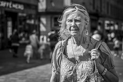 Summer Breeze (Leanne Boulton) Tags: urban street candid portrait portraiture streetphotography candidstreetphotography candidportrait streetportrait streetlife eyecontact candideyecontact old elderly woman female face lady eyes expression emotion mood spring breeze wind weather sunlight sunshine tone texture detail wrinkles depthoffield bokeh skin naturallight outdoor light shade shadow city scene human life living humanity society culture lifestyle people canon canon5dmkiii 70mm ef2470mmf28liiusm black white blackwhite bw mono blackandwhite monochrome glasgow scotland uk
