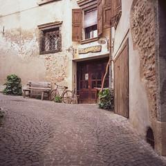 Asolo.jpg (francesco19739) Tags: asolo veneto borgo bici bicycle door lamps pebbles windows plant bench panchina alley