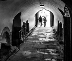 Walking into the light. (James-Burke) Tags: people passageway silhouettes cathedral durham couple street