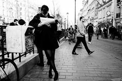 en attendant Paris (laurent.triboulois) Tags: woman femme ville city downtown paris saintpaul street rue pavé livre blackandwhite