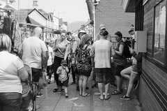 Easter Market Mayhem (Howie Mudge LRPS BPE1*) Tags: yashica35gsn spidermancamera rangefinder fomapan400 caffenol caffenolch epsonv800 people men women children selfdevelop analog analogphotography 35mm 35mmfilmphotography film filmphotography filmisnotdead filmcamera filmrevival 35mmfilmcamera candid street streetphotography blackandwhite mono monochrome