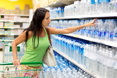 woman buys a bottle of water in the store (carissa.deming) Tags: water bottle supermarket buyer customer shelf plastic waterbottle drink soda women mineral woman market shop buy purchase people adult caucasian sale display store retail choice variety carry choose drinks purchasing shopping merchandise food environment buying norway