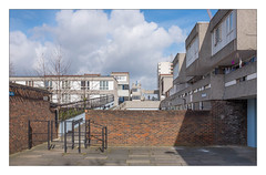 The Built Environment, South East London, England. (Joseph O'Malley64) Tags: thebuiltenvironment newtopography newtopographics manmadeenvironment manmadestructures buildings structures housingestate councilestate housing councilhousing housingassociations privateownership homes dwellings abodes blocksofflats flats highdensityhousing southeastlondon london england uk britain british greatbritain steelreinforcedconcretestructures reinforcedconcretestructures concretestructures concrete brickwork bricksmortar cement pointing wall walls rotatingsecurityspikes securityspikes balconies walkways ratruns steelfencing signs signage towerblock highrise aerials boostermast towercrane stairwells trees ornamentalcherrytrees gate gateway kissinggate pavement laundry wiring electricalwiring waterdamage frostdamage hygroscopicsaltsinbrickwork ramps inclines gradients flues urban urbanlandscape fujix fujix100t accuracyprecision architecture architecturalphotography documentaryphotography britishdocumentaryphotography