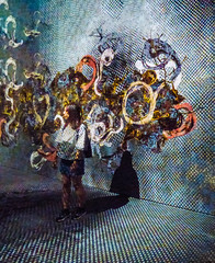 Reading Her Mind (Steve Taylor (Photography)) Tags: mindreading impermanentlife sanctuary squiggles whirls art abstract graphic impressionist museum colourful girl asia singapore shape curve pattern circle shadow texture artsciencemuseum