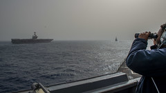 190424-N-SS350-0077 (NavyOutreach) Tags: ussbainbridge ddg96 deployment maritimesecurityoperations destroyersquadrontwo desron2 sailors usn unitedstatesnavy forgedbythesea csg12 carrierstrikegroup abrahamlincolncarrierstrikegroup seaman devontaedaniel observes helicopter nimitzclass aircraftcarrier ussjohncstennis cvn74 bridgewing unitedstates