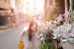 Young woman smiling at the back of flowers (Apricot Cafe) Tags: imgr19399 asia asianandindianethnicities healthylifestyle japan japaneseethnicity millennialgeneration tokyojapan backlit candid capitalcities carefree casualclothing charming cheerful copysapce day enjoyment flower flowershop focusonfront freedom happiness kichijoji leisureactivity lifestyles longhair oneperson oneyoungwomanonly outdoors people photography realpeople selectivefocus shopping sky smiling springtime store street sunlight threequarterlength traveldestinations weekendactivities youngadult youthculture