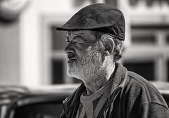 'A Keen Eye' (Canadapt) Tags: man street cap wink portrait bw coimbra portugal canadapt