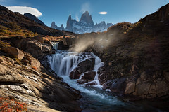 Mist Rising (arrtography) Tags: illuminate glow waterfalls arr falls nature mist warmth southamerica fall light scenic sky dramatic autumn anthonyrryan landscape fitzroy arrtography nationalpark mountains mtfitzroy longexposure rocks ndfilter adventure andes anthonyryan argentina hiking afternoon peaks water hiddenfalls river outdoors mountain