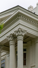 Corinthian Capitals, Bell Place — Lexington, Kentucky (Pythaglio) Tags: house dwelling residence lexington kentucky unitedstatesofamerica historic eclectic twostory cubeshaped brick fayettecounty greekrevival columns pedimented pediment corinthian capitals dentils entablature threebay doublepile centralpassage chimneys nrhp nationalregister ca1890 78001312 bellplace