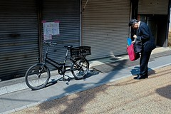 where's the keys to the bike (andrewchewcc) Tags: bicycle street man suits suit bags bag store japan tokyo ginza working