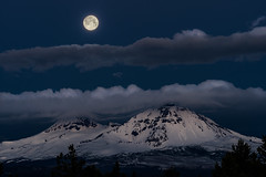 Full Moon Over Cloud Layers (TierraCosmos) Tags: fullmoon moon moonset settingmoon mountains mountainscape northsister middlesister cascades cascaderange oregoncascades oregon centraloregon landscape dawn bluehour morning clouds moonlight