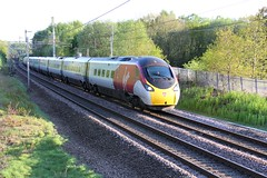 Virgin Trains Pendolino 390049 with 9S85 London Euston to Glasgow Central passing Standish Lancashire on the WCML 10' late on a sunny Spring evening 29th April 2019 © (steamdriver12) Tags: lancashire england spring west coast main line virgin trains pendolino no 390049 9s85 london euston glasgow central standish wcml 10 late sunny evening 29th april 2019 25kv electric modern traction