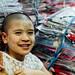 Child in Thanakha in Garment Market