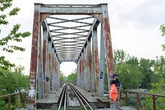 Girl and the bridge (piotr_szymanek) Tags: ania aniaz woman young skinny face portrait outdoor hat bridge rail railway pink 1k 20f 50f 5k 10k 100f 20k