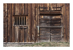 OW XXVII ([ Time - Beacon ]) Tags: tb barn wooden texture building decay rural doorway doors window lines sweden weathered old