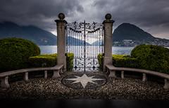 Das Tor (Chris Buhr) Tags: tor gate lake lugano see schweiz switzerland suisse wolken clouds dark berge mountains alpen landschaft leica m10