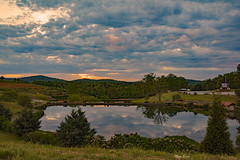 Sundown On A Cloudy Day (mevans4272) Tags: mountain hill water refections clouds flowers trees grass road path orchard