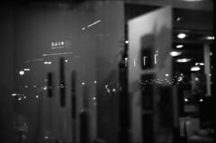 Bank of China (lumpy79) Tags: praktica mtl5 helios44m 258 ilford hp5 400 1600 budapest blackandwhite bw feketefehér kirakat window reflection