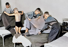 Morning chore at camp (theirhistory) Tags: boy child children kid beds blanket sheets jumper trousers pants