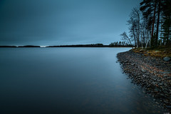 Rocky beach (Rico the noob) Tags: dof rock d850 15mm landscape nature water outdoor lake stones clouds longexposure mf beach rocks tree travel forest horizon published sky trees 2018 manualfocus finland 15mmf24