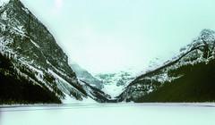 Banff NP, Canada: Lake Louise in Winter (rocinante11) Tags: banff nationalpark canada alberta lake lakelouise mountains film filmcamera fujifilm fujivelvia xpro crossprocess fog