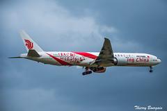 "[CDG] Air-China ""Smiling China Livery"" Boeing 777-300ER _ B-2035 (thibou1) Tags: thierrybourgain cdg lfpg spotting aircraft airplane nikon d7100 airchina smilingchina boeing b777300er b773 b2035 livery tamron sigma landing b777300"