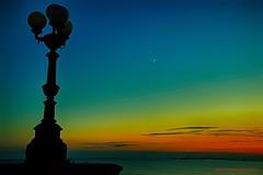 Taranto, tramonto. (eumag) Tags: allaperto azzurro acquaazzurra acqua blu blue barche barca colori clouds cielo colors color colore dark mediterraneansea golfoditaranto gulfoftaranto hdr italia italy ioniansea luce light lampione lampioni mare marjonio mediterraneo nikon nuvole outdoor onde puglia panorama sky sea ship taranto vacanza nikond300