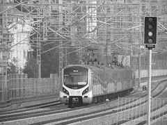 A 5-car E32000 class 'Marmaray' electric unit waits to reverse back into Söğütlüçeşme station, Istanbul, to form a service to Zeytinburnu (Steve Hobson) Tags: söğütlüçeşme istanbul turkish railways tcdd e32000 marmaray emu hyundai rotem