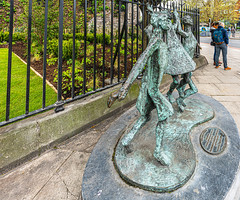 MILLENIUM CHILD  BY JOHN BEHAN ACROSS THE STREET FROM CHRIST CHURCH CATHEDRAL [AT THE PEACE PARK]-152103 (infomatique) Tags: milleniumchild johnbehan christchurchplace sculpture publicart christchurchcathedral peacepark ireland urbanculture williammurphy infomatique fotonique sony a7riii sigma 14mm wideanglelens