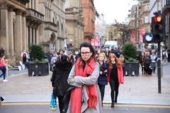 Eye contact (HughGilliland) Tags: canon2470mmf28liiusm canon5dmkiii tones tone mood expression redscarf female women glasses city urban streetscene uk scotland glasgow streetportrait streetstyle street streetphotography candid eyecontact