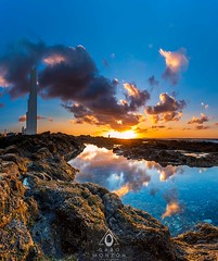 Reflejos del Ocaso (Gabo Monzón) Tags: gabo gabomonzón tenerife gabomonzónfotografía granangular wideangle landscape paisaje atardecer sunset nubes clouds faro reflejo reflection nikon nikond750 irix irix15mm costa coast canarias canary