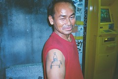another street king with a sick tattoo! (subway rat) Tags: 35mm analog film analogphotography filmphotography mjuii mju2 olympusmjuii olympus μmjuii kodak kodakfilm kodakultramax400 streetphotography streetlife streetphoto everybodystreet streetkings bangkok thailand asia tattoo blacktattoo filmforever filmisnotdead filmcamera shootfilm ishootfilm staybrokeshootfilm