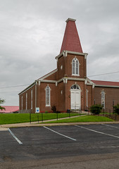 May's Lick Baptist Church — May's Lick, Kentucky (Pythaglio) Tags: church building structure mayslick kentucky unitedstatesofamerica historic onestory brick 1883 gothicrevival masoncounty tower steeple buttresses roundarched segmentalarched windows 11windows bosses parkinglot clouds baptist religion