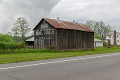 Tobacco Barn — Huntington Township, Brown County, Ohio (Pythaglio) Tags: barn building structure historic aberdeen ohio unitedstatesofamerica tobaccobarn tobacco mailpouch clouds trees road browncounty huntingtontownship