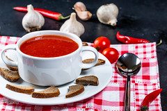 Tomato soup in a tureen with croutons, garlic, chili and a spoon on the table (wuestenigel) Tags: lay color garlic chili background dinner hot vegetarian homemade meal delicious organic view flat spoon italian gourmet soup tomato cooking dried diet mediterranean bread gazpacho eating healthy cuisine tasty puree crackers food creamy red vegetable tureen top lunch black bowl fresh cream vegan kitchen