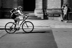 Carrera on Broad Street (Silver Machine) Tags: oxford oxfordshire streetphotography street candid girl bike bicycles cycling sunglasses walking broadstreet blackwhite bw mono monochrome fujifilm fujifilmxt10 fujinonxf35mmf2rwr