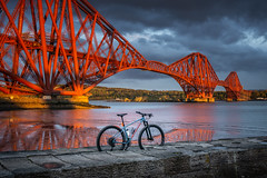 Specialized Engineering (ianrwmccracken) Tags: sunshine 29er rail bridge reflection specialized sony bike structure sea cantilever sky sunlight wall worldheritagesite stone sunset lowtide hardtail bicycle chisel a6000 unesco blue fife scotland railway river cloud red evening lothian steel engineering coast cycling forth
