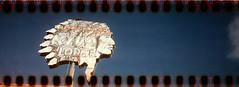 Kiva Lodge (No Stone Unturned Photography) Tags: camera art film 35mm polaroid high kodak holes 400 definition agfa expired deco folding jiffy 1933 sprocket 616 six16 sign hotel motel panoramic arizona mesa